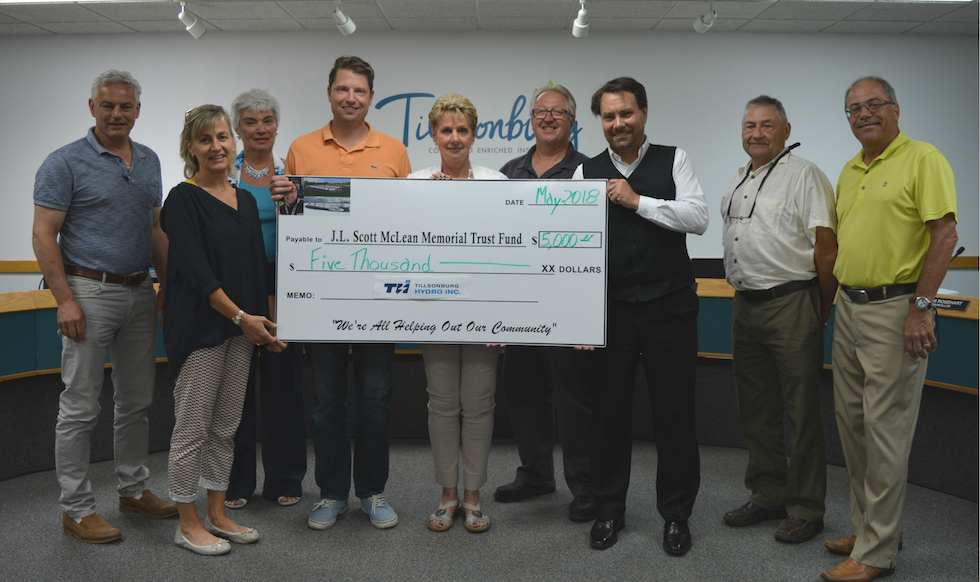 Board of Directors presented a $5,000 cheque